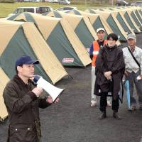 Alpinist Ken Noguchi leads volunteers to set up tents for Kumamoto quake evacuees
