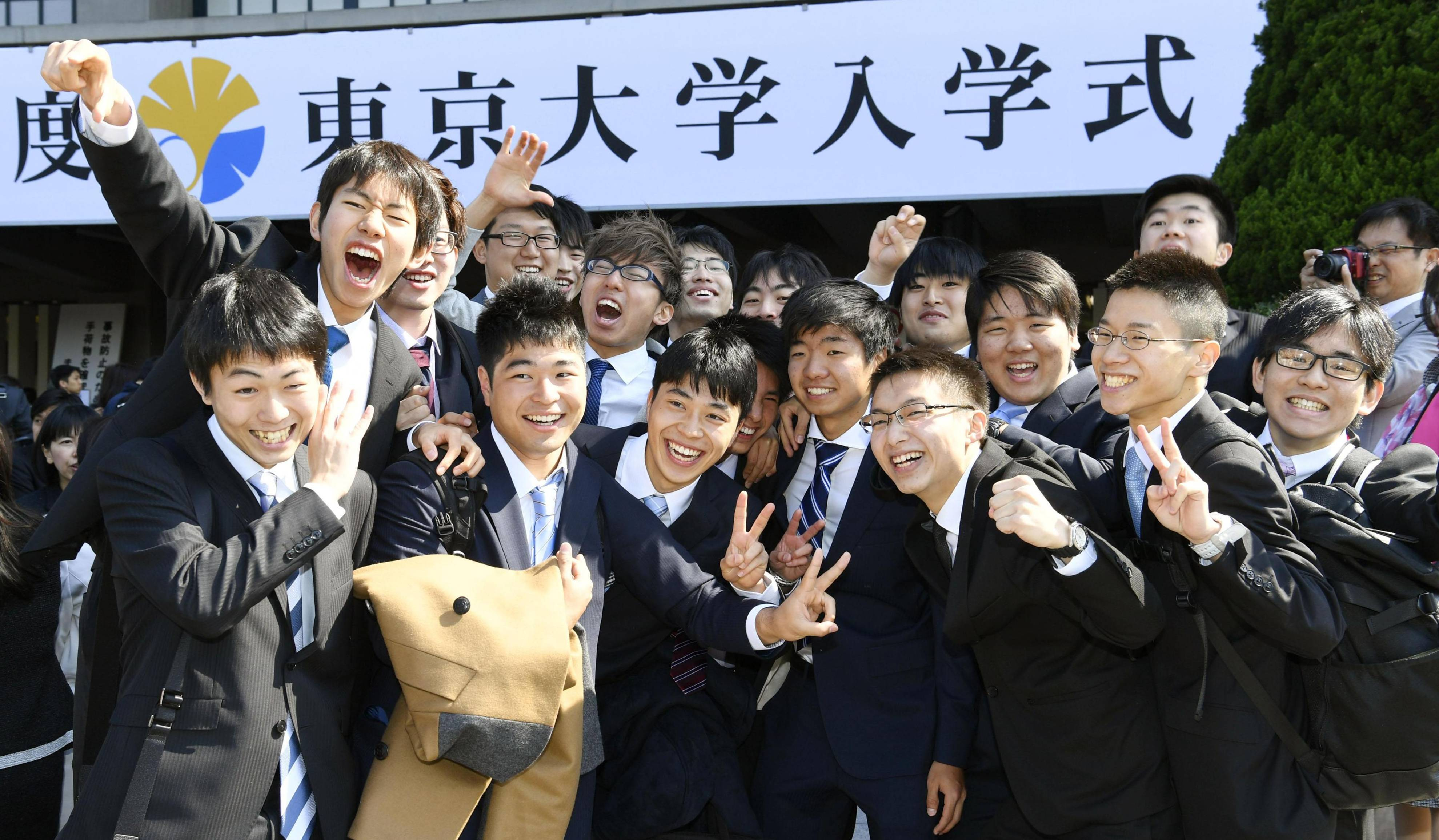 New students pose for a photo before the University of Tokyo's annual entrance ceremony Tuesday at Nippon Budokan Hall in Chiyoda Ward. | KYODO