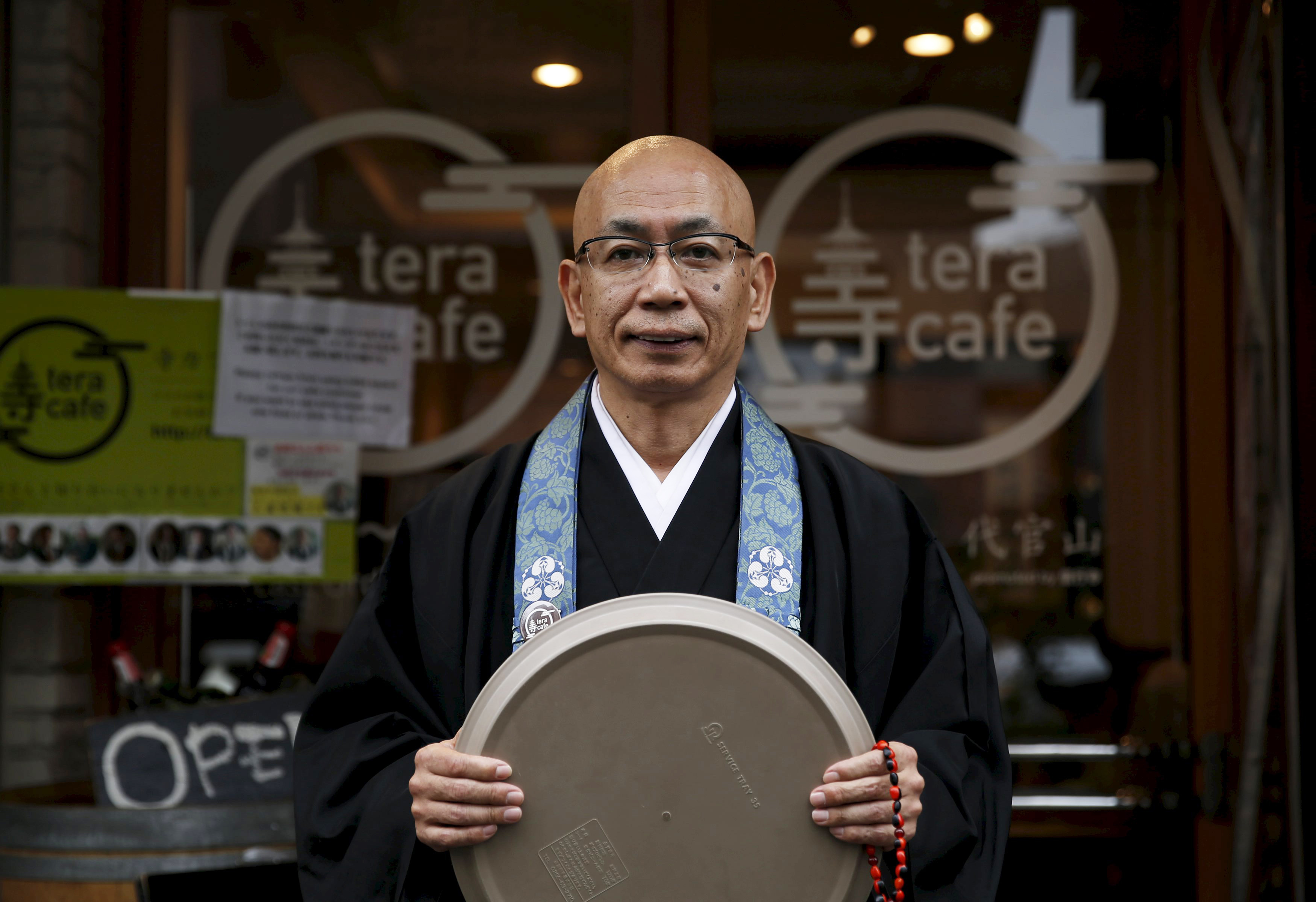 Belief and beer: Buddhist monk Shokyo Miura is an on-site priest at Tokyo's Tera Cafe, which serves coffee and alcoholic beverages. | REUTERS