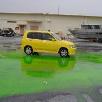 Sea dye leaks from a tank on Kadena Air Base in an undated photo. No records exist for the spill, suggesting it was unreported even within the military. | IMAGE RELEASED UNDER THE U.S . FREEDOM OF INFORMATION ACT