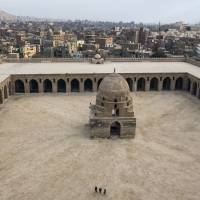A panoramic view of Cairo, as seen from the Mosque of Ahmed Ibn Tulun's exterior stone staircase. | AP