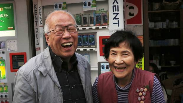 Happy pair: Tobacco shop owner Teruyo Mitate and architectural photographer Motonari Sato both live in a Tokyo neighborhood of nagaya (wooden row houses).