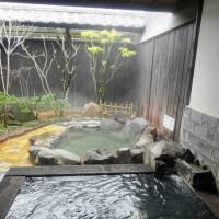 Sumptuous soak: A private hot spring at Yu-an in the town of Ueki, Kumamoto Prefecture, features an outdoor bath. | MANDY BARTOK