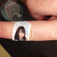 Healing touch: A Band-Aid bearing the likeness of AKB48 member Yuki Kashiwagi is one of many branded items created for the idol group's predominantly male fan base. Recently AKB's sister group HKT48 has been criticized for a song with sexist lyrics, which was written by Yasushi Akimoto. Despite this promotion of traditional gender roles in Japan, women often have more agency in relationships than men.   FLICKR / KARL BARON / CC BY 2.0