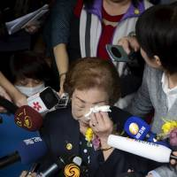 Remembering the past: Former 'comfort woman' Chen Lien-hua wipes tears as she speaks to the media during a ceremony unveiling the nameplate of a museum dedicated to Taiwan's comfort women on March 8, International Women's Day, in Taipei. | REUTERS