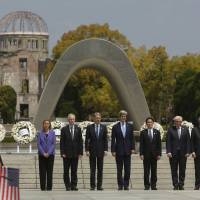 Needed gesture: G-7 foreign ministers stand together after placing wreaths at the cenotaph at Hiroshima Peace Memorial Park and Museum in Hiroshima. There's a chance that U.S. President Barack Obama will follow suit.   REUTERS