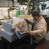 All the news that's unfit for print: A Japanese fisherman reads the morning paper while waiting for customers in Tokyo's Tsukiji fish market. Publishers, wary of financial penalties imposed on media companies in defamation lawsuits over the past 20 years are feeding readers trivial, but titillating sexual and financial scandals in lieu of exposing institutional wrongdoing. | ISTOCK