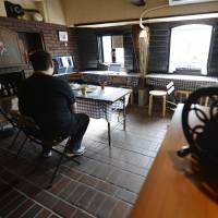 Different approach: A hikikomori (shut-in) who works at the Akarenga cafe in Suita, Osaka, says he has felt more calm and stable since getting a job there thanks to the help of NPO Full House. | KYODO