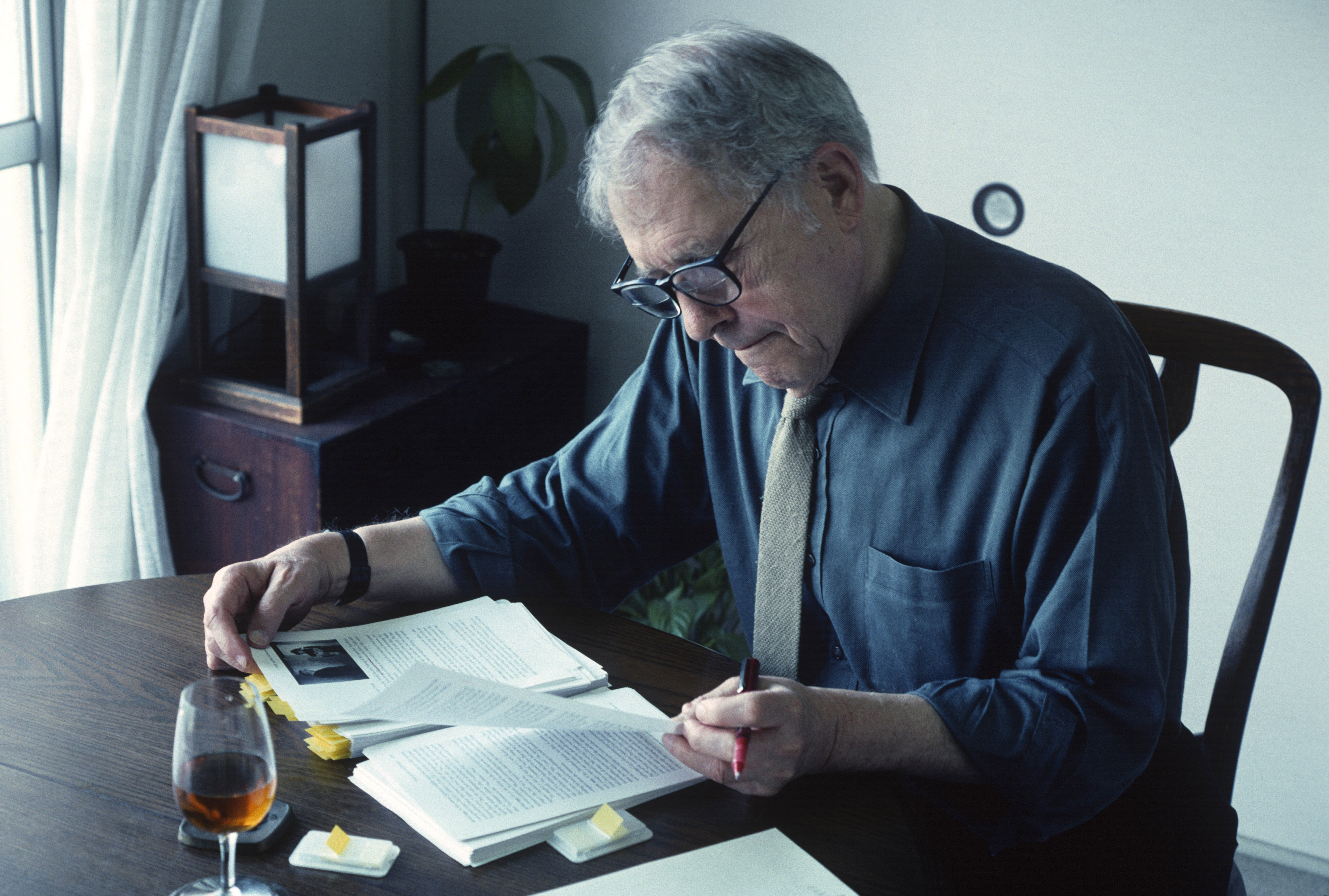 Embedded reflections: Donald Richie in 2004, in his home beside Tokyo's Ueno Park, overseeing the manuscript of his book 'The Japan Journals: 1947-2004.' | STEPHEN MANSFIELD