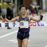Takayuki Tanii crosses the line to win the 50-km walk national title on Sunday in Wajima, Ishikawa Prefecture. | KYODO