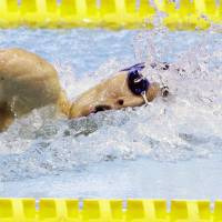 Kosuke Hagino swims the freestyle portion of the 200-meter individual medley final at the national championships on Saturday at Tokyo Tatsumi International Swimming Center. Hagino won the race in 1 minute, 55.07 seconds, breaking his own national record. | KYODO
