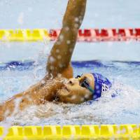 Ryosuke Irie captures his 10th straight national title in the men's 200-meter backstroke on Saturday. | KYODO