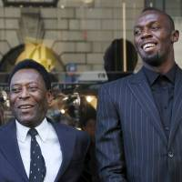 Jamaican sprinter Usain Bolt (right) poses with Brazilian soccer legend Pele at a sponsor's event in New York on Tuesday. | REUTERS