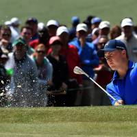Spieth maintains lead as McIlroy surges on eventful day at Augusta