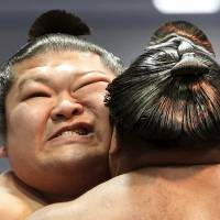 In pictures: Hakuho headlines somber spring sumo festival at Yasukuni Shrine