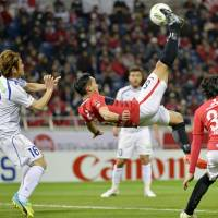 Reds sink 10-man Ventforet to top J. League table