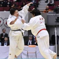 Megumi Tachimoto (left) and Kanae Yamabe compete in the final of the national judo championships in Yokohama on Sunday. | KYODO