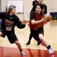 Guard Manami Fujioka (right) drives on Asami Yoshida during a practice session for the Japan women's national team on Tuesday. | KAZ NAGATSUKA