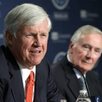 John Stanton (left) speaks at a news conference in Seattle on Wednesday as current Seattle Mariners Chairman and CEO Howard Lincoln looks on.   AP