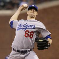 Dodgers give up on no-hitter, lose in 10th