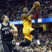 LeBron carries Cavaliers in rout of Nets