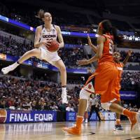 UConn routs Syracuse for fourth straight title