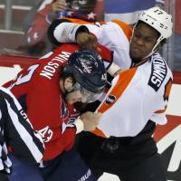 Caps lean on familiar formula to top Flyers in Game 1