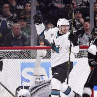Sharks hold nerve to eliminate Kings