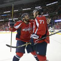 Oshie scores in overtime to lift Capitals over Penguins in Game 1