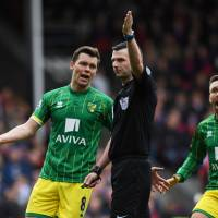 Norwich's Jonny Howson (left) and Gary O'Neil react to a decision by the referee during a match against Crystal Palace on April 9 at Selhurst Park   REUTERS
