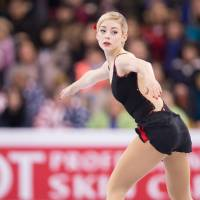 Gold shines in short program; Mao flops