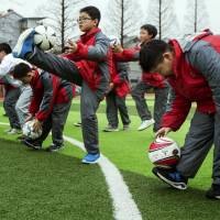 China announces ambitious plan to join world soccer elite
