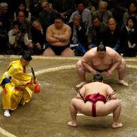 Ichinojo (rear), seen competing against Endo, enters May's Summer Grand Sumo Tournament with a shot at winning his first top-flight title. | MARK BUCKTON
