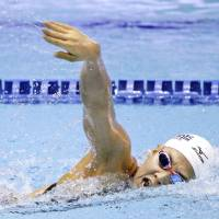 Miho Teramura competes in the women's 200-meter individual medley final on Thursday at the national championships. Teramura won the race in 2 minutes, 9.87 seconds at Tokyo Tatsumi International Swimming Center. | KYODO