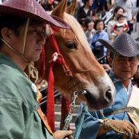 Archers prepare for Asakusa Yabusame, a horseback archery display, held annually at Sumida Park near Asakusa in Tokyo. This year 30 mounted archers participated in the event, which was held on April 16. | SATOKO KAWASAKI