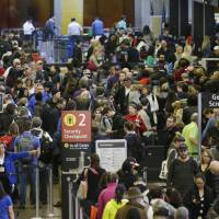 Senators tell airlines to drop check-in bag fees to move lines along