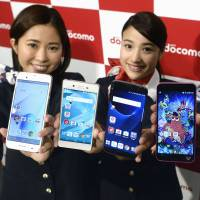 New NTT Docomo Inc. smartphone models are unveiled in Tokyo last week. Police will be able to extract GPS data. | KYODO
