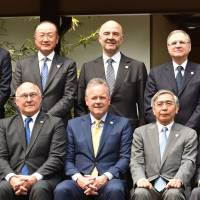 G-7 finance ministers and central bank chiefs pose during a photo session in Sendai on Friday. | AFP-JIJI