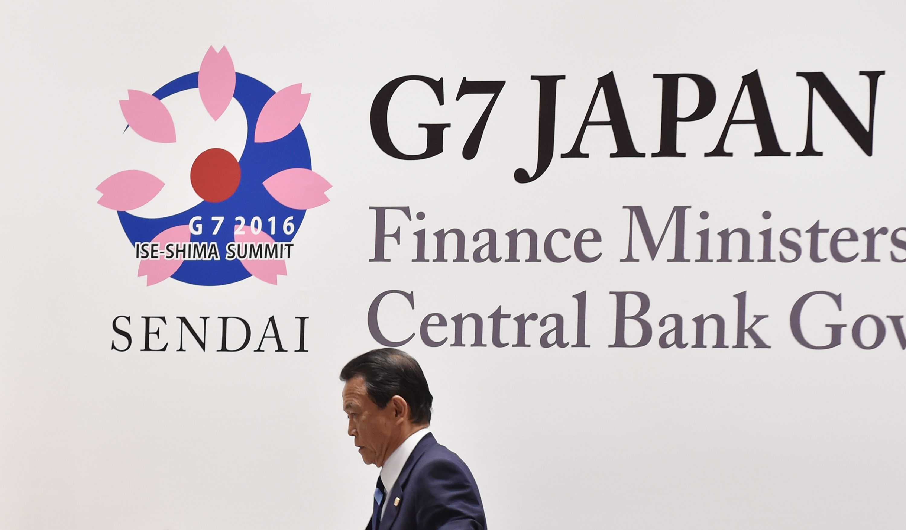 Finance Minister Taro Aso leaves a news conference after the Group of Seven finance ministers and central bank governors' meeting in Sendai Saturday. | AFP-JIJI