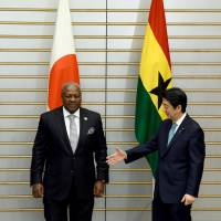 Ghana President John Dramani Mahama is greeted by Prime Minister Shinzo Abe before their talks at Abe's office in Tokyo on Wednesday. | AP