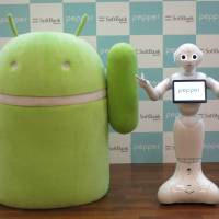 Android's Bugdroid mascot (left) poses with SoftBank Corp.'s Pepper robot at the company's headquarters in Tokyo on Thursday. The event was held to demonstrate Pepper's compatibility with Android software. | KAZUAKI NAGATA