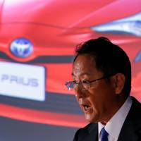 Toyota braces for one-third less profit on stronger yen, emerging markets