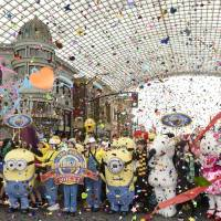 Movie characters celebrate a record number of visitors in fiscal 2015 to Universal Studios Japan in Osaka Prefecture during a ceremony in March. The operating company of the popular theme park said Wednesday it will scrap a plan to build another park in Okinawa.   KYODO