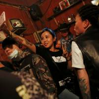 Punks not dead: Visitors take pictures of themselves at Mao Live House in Beijing during the club's last public concert. | REUTERS