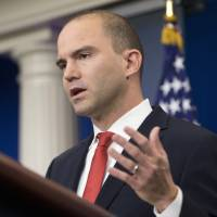 White House on damage control after aide's magazine profile