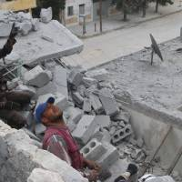 Monitor says rebel rockets killed 19 in Aleppo, hit maternity hospital amid clashes with regime