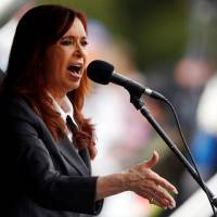 Argentina's Kirchner charged with fraud, assets frozen
