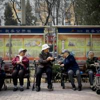 As population ages, Beijing tracks its elderly as they take buses, go shopping