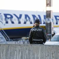 Manchester-bound Ryanair jet evacuated near Oslo hours after false bomb scare also clears stadium