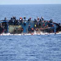 Footage captures capsizing of migrant boat as Italian rescuers arrive
